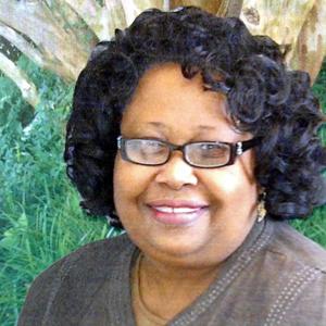 Dr. Louella Tate