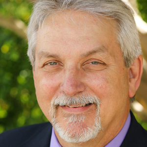 Dr. Ray Helmcamp, Executive Director
